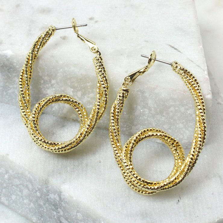 A photo of the Safety Pin Hoop Earrings product