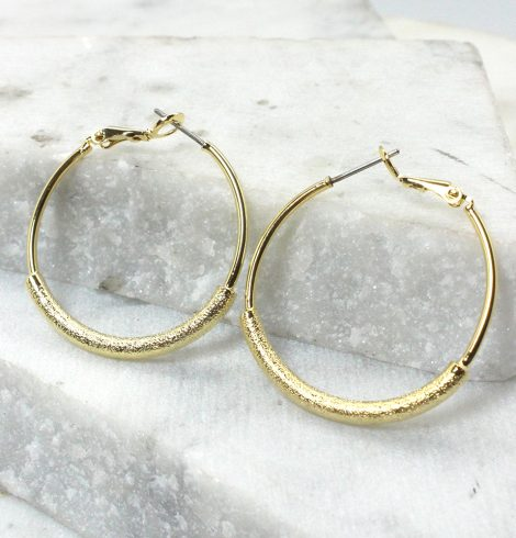 A photo of the Sand Paper Hoop Earrings product