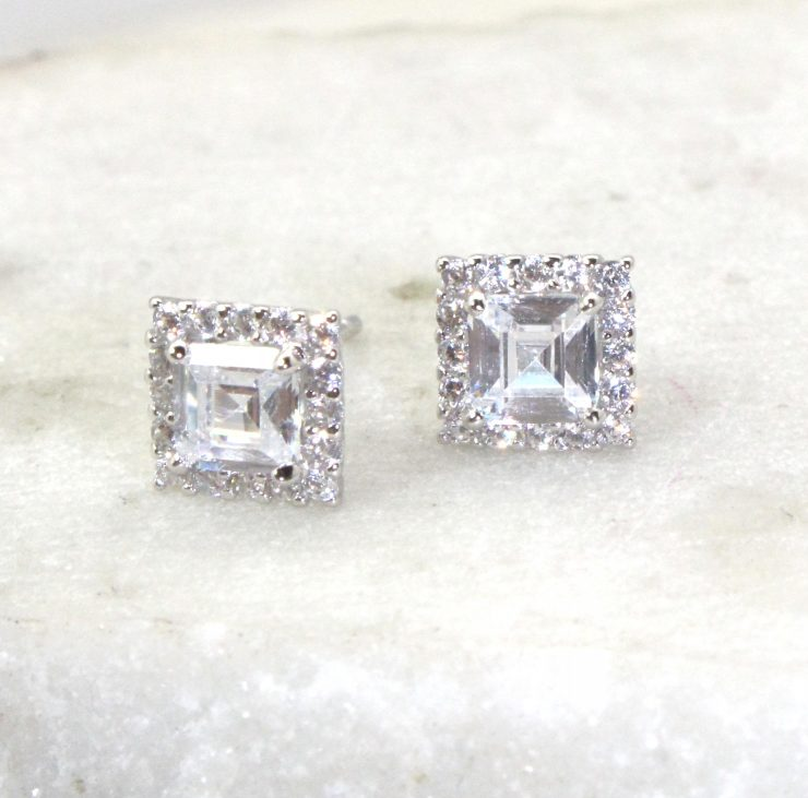 A photo of the Square Stud Earrings product