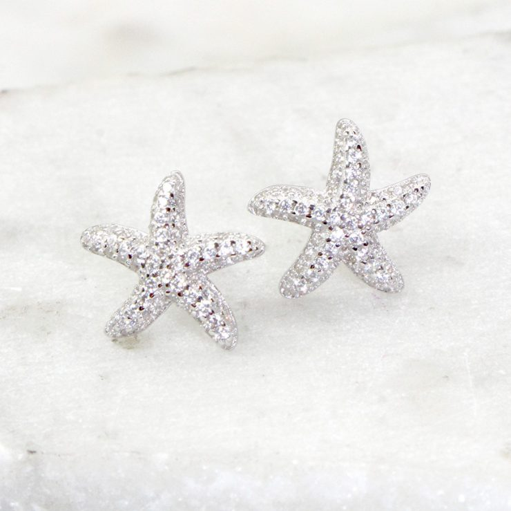 A photo of the Starfish Stud Earrings product