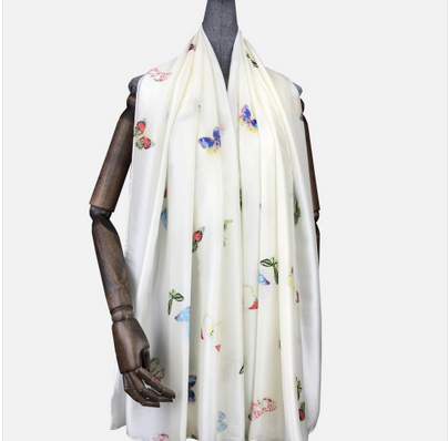 A photo of the Butterflies Silky Scarf product
