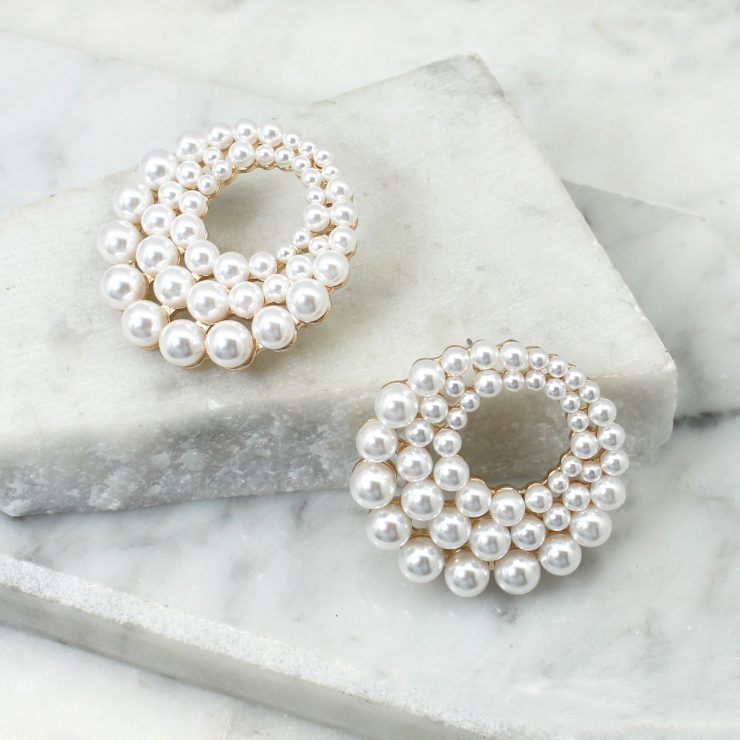 A photo of the Brianna Pearl Earrings product
