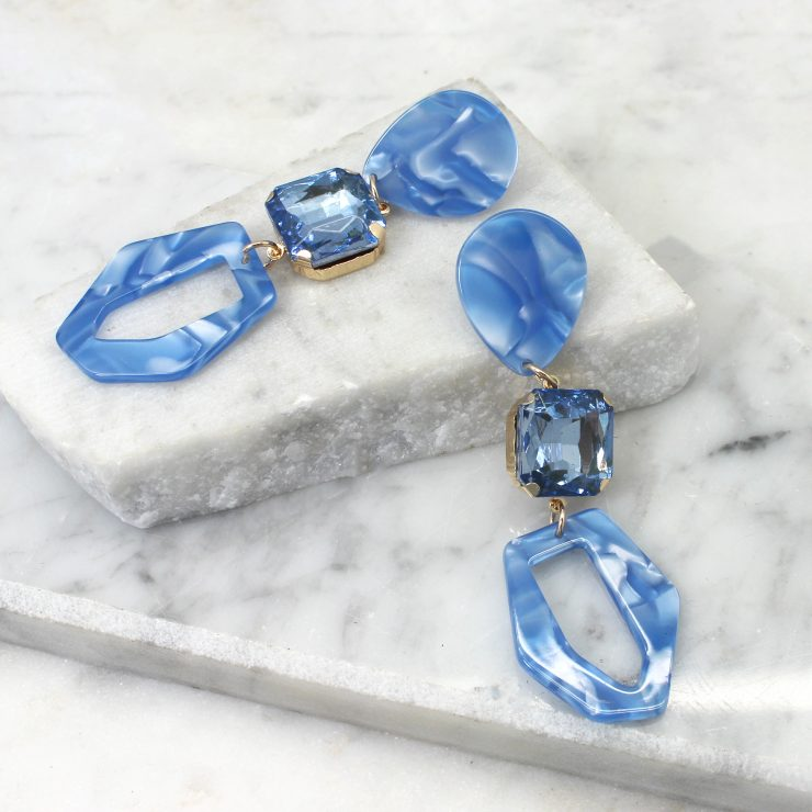 A photo of the Luna Earrings In Blue product