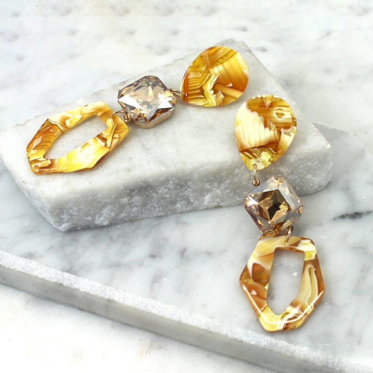 A photo of the Luna Earrings In Yellow product