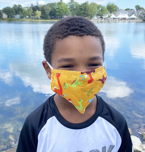 A photo of the Dino Party Kids' Mask In Orange product
