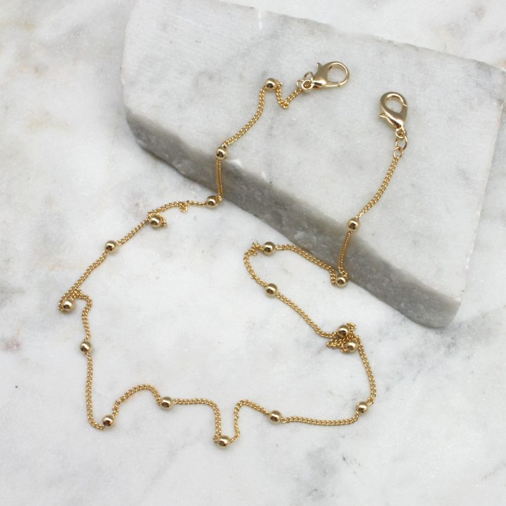 A photo of the Gold Beaded Mask Chain product