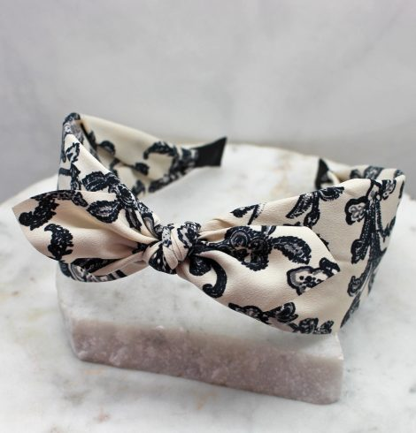 A photo of the Ivory & Navy Paisley Headband product