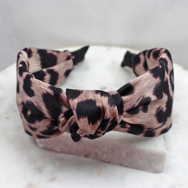 A photo of the Leopard Headband In Taupe product