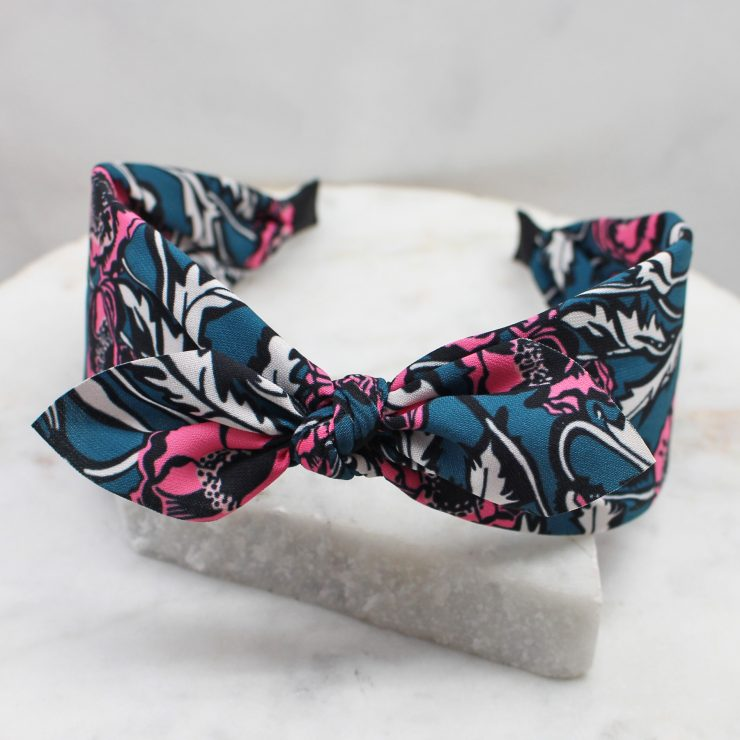 A photo of the Pink Poppy Flower Headband product