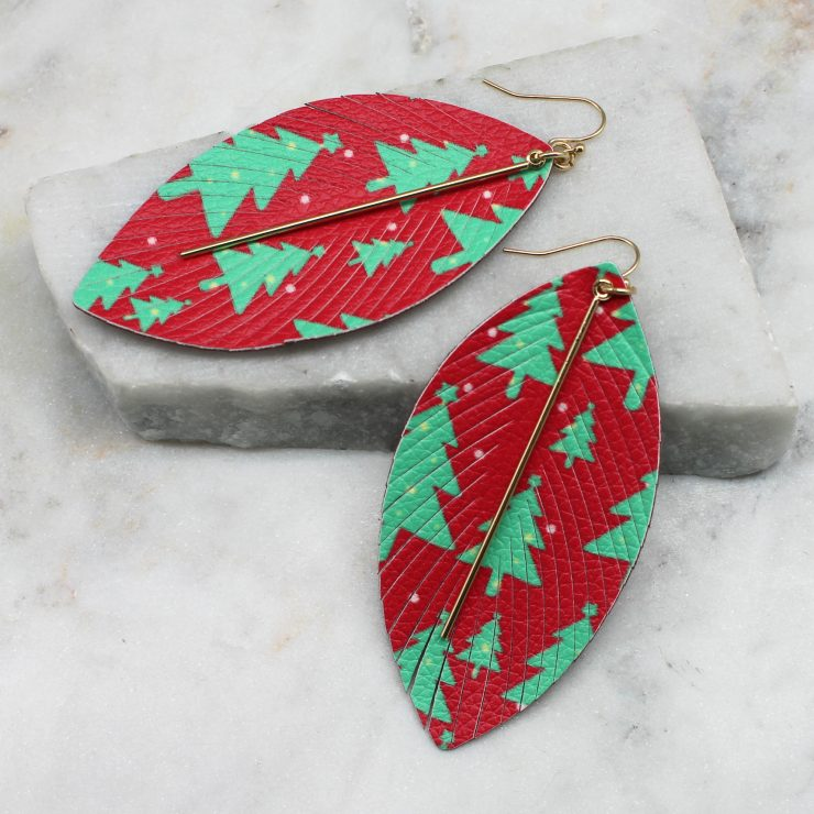A photo of the Christmas Tree Feather Earrings product