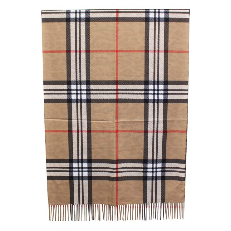 A photo of the Plaid Reversible Scarf In Brown product