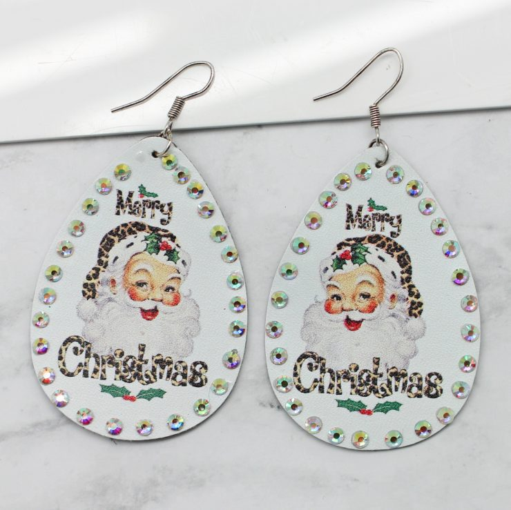 A photo of the Leopard Santa Earrings product