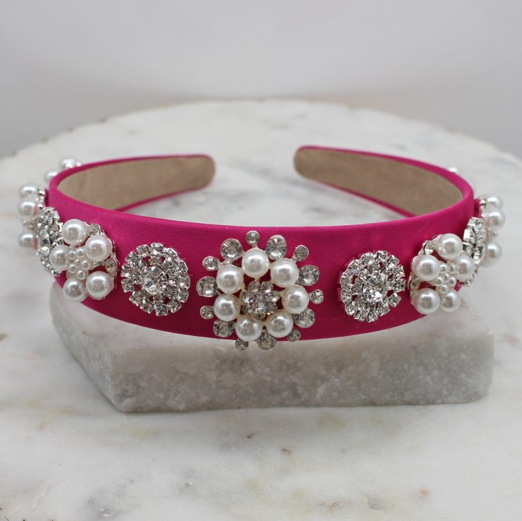 A photo of the Elegant Pearl Headband In Pink product