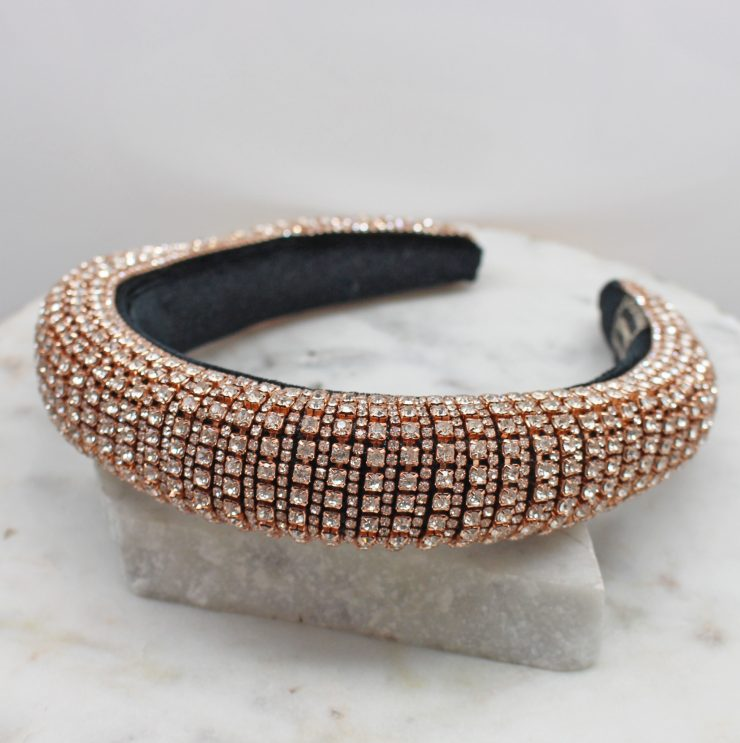 A photo of the Rhinestone Headband In Rose Gold product