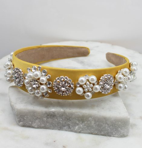 A photo of the Elegant Pearl Headband In Yellow product