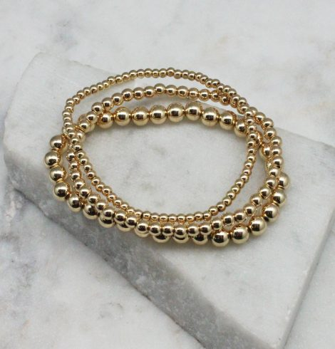 A photo of the Gold Beaded Stackable Bracelets – Set of 3 product
