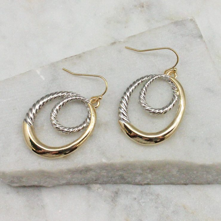 A photo of the Lani Earrings In Two Tone product