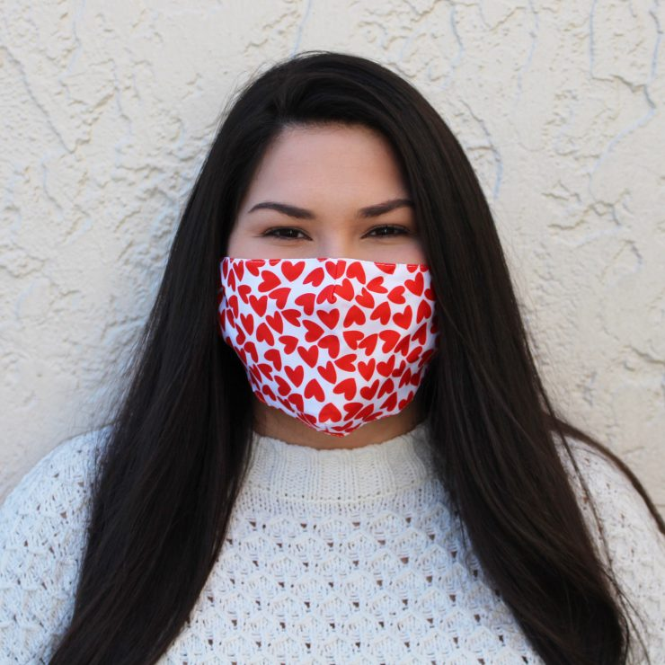 A photo of the Red Hearts Face Mask In White product