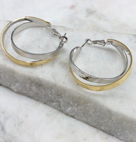 A photo of the Twisted Up Earrings In Two Tone product