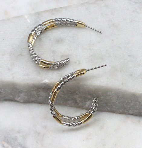 A photo of the Twist & Shine Hoop Earrings product