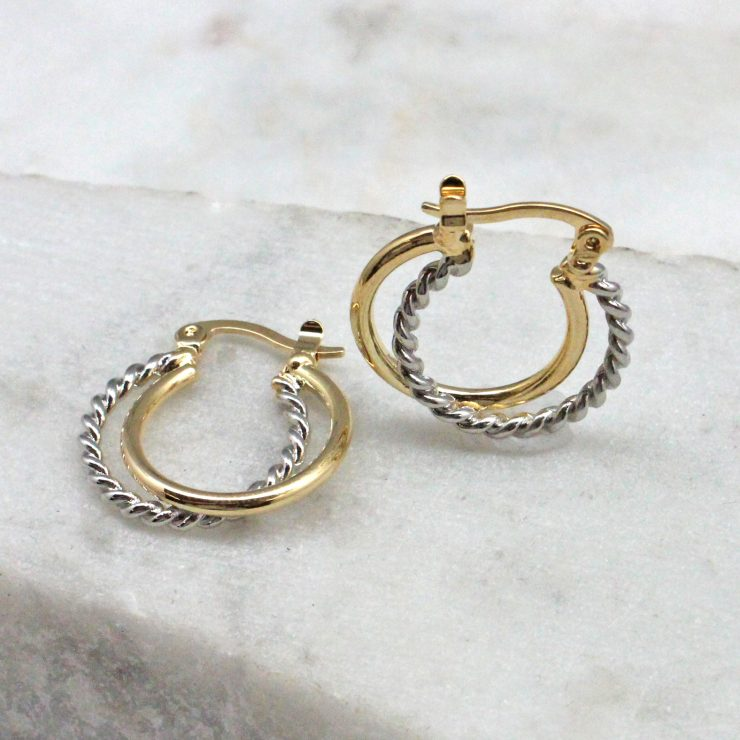 A photo of the Twisted Up Hoop Earrings product