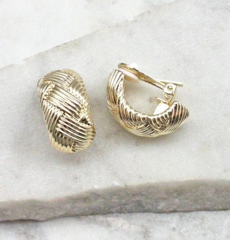 A photo of the Woven Clip On Earings In Gold product