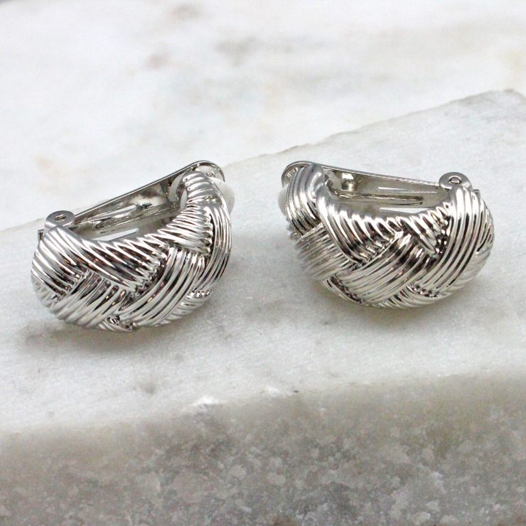 A photo of the Woven Clip On Earrings In Silver product