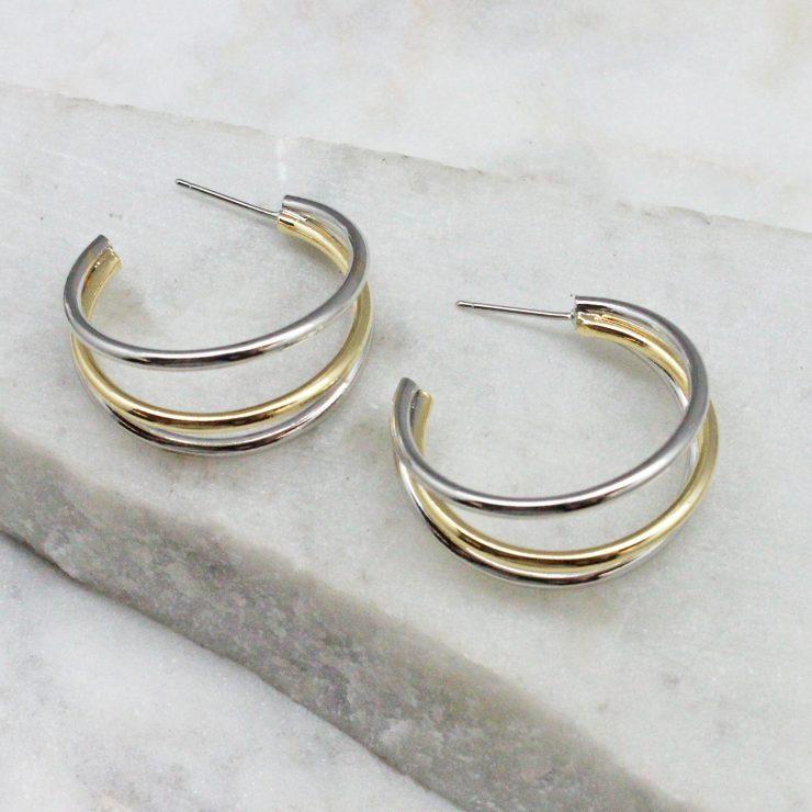 A photo of the Anya Hoop Earrings product