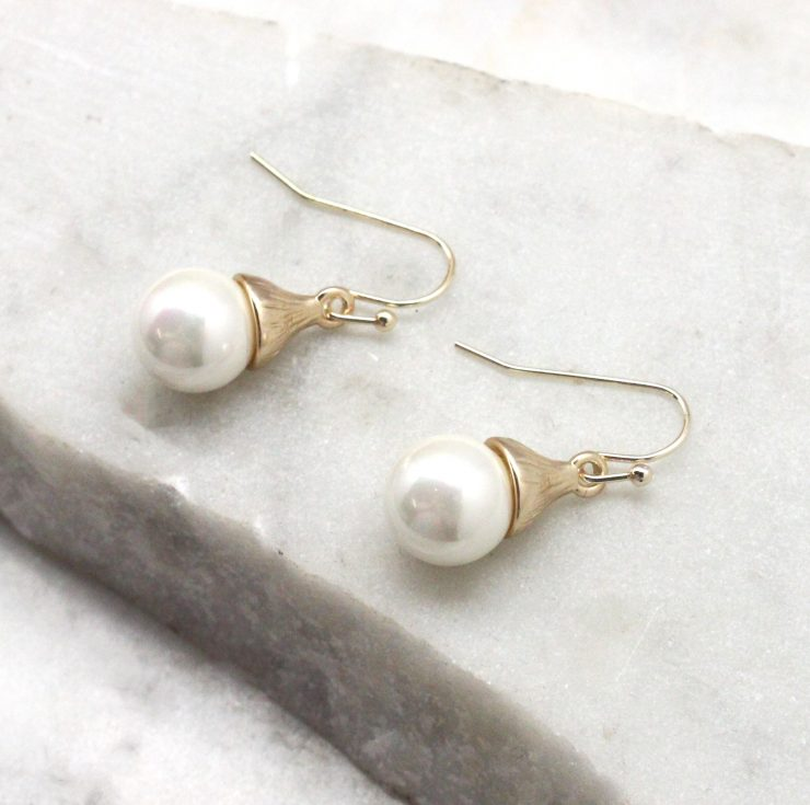 A photo of the Pearl Drop Earrings product