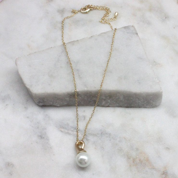 A photo of the Pearl Drop Necklace product