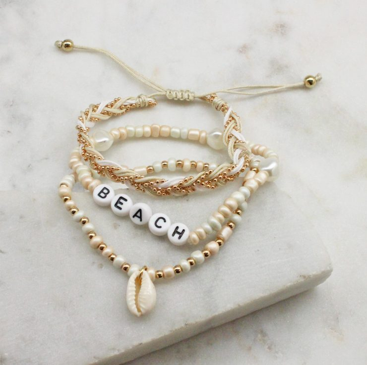 A photo of the Beach Stack Bracelets In Ivory product