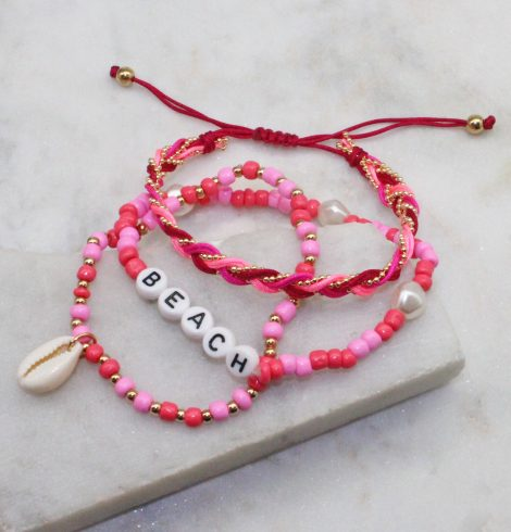 A photo of the Beach Stack Bracelets In Pink product