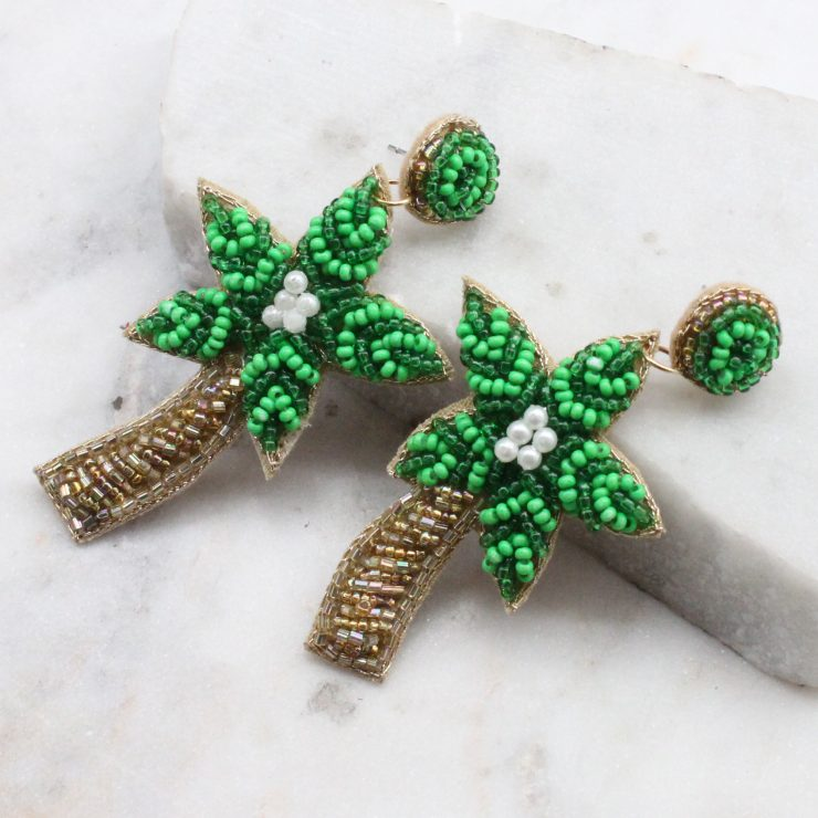 A photo of the Beaded Palm Tree Earrings product