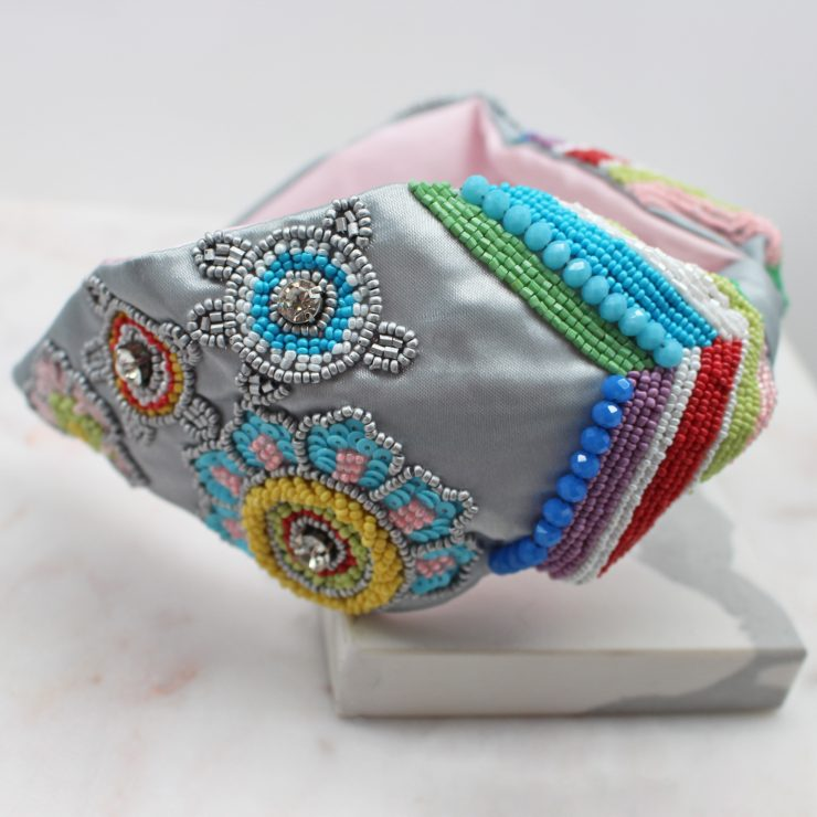 A photo of the Grey Floral Beaded Headband product