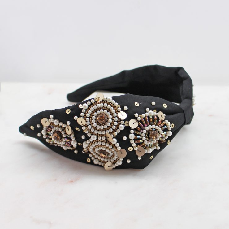 A photo of the Black & Gold Beaded Headband product