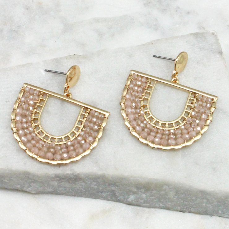 A photo of the Jasmine Earrings In Light Pink product