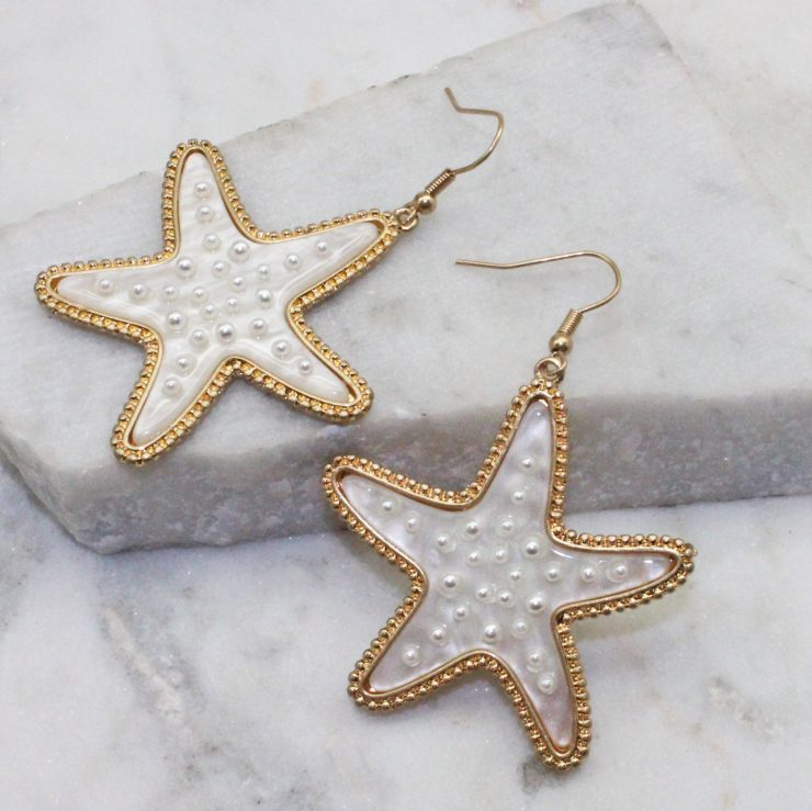 A photo of the Starfish Pearl Earrings product