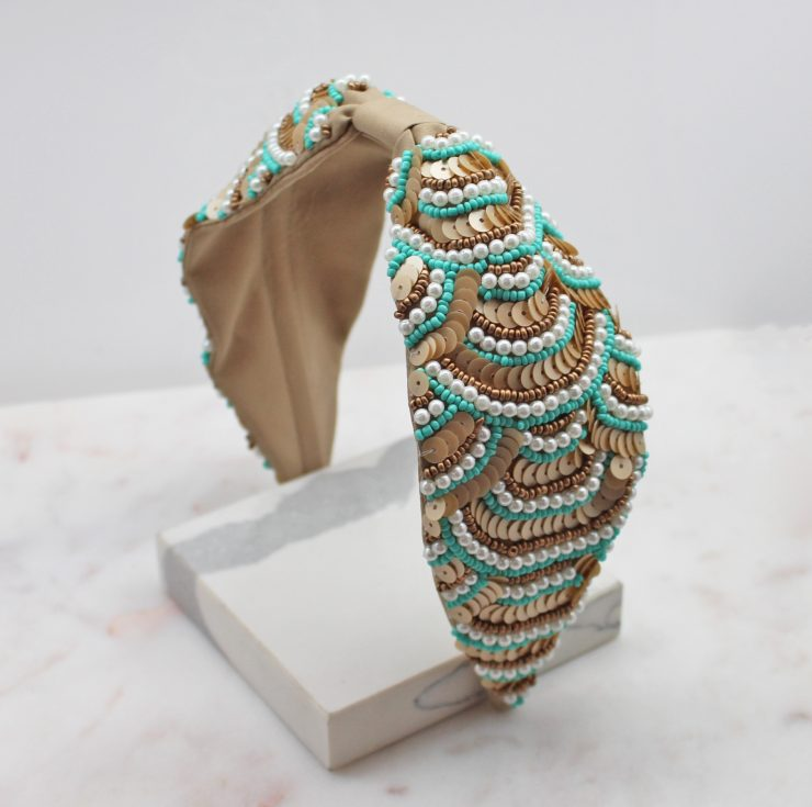 A photo of the Turquoise & Taupe Beaded Headband product