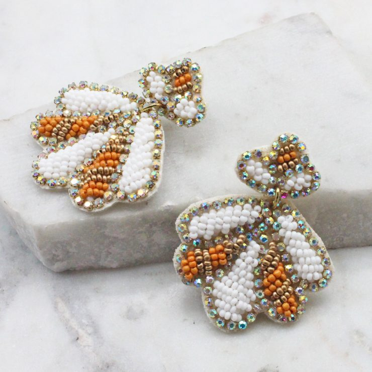 A photo of the Beaded Shell Earrings In White product