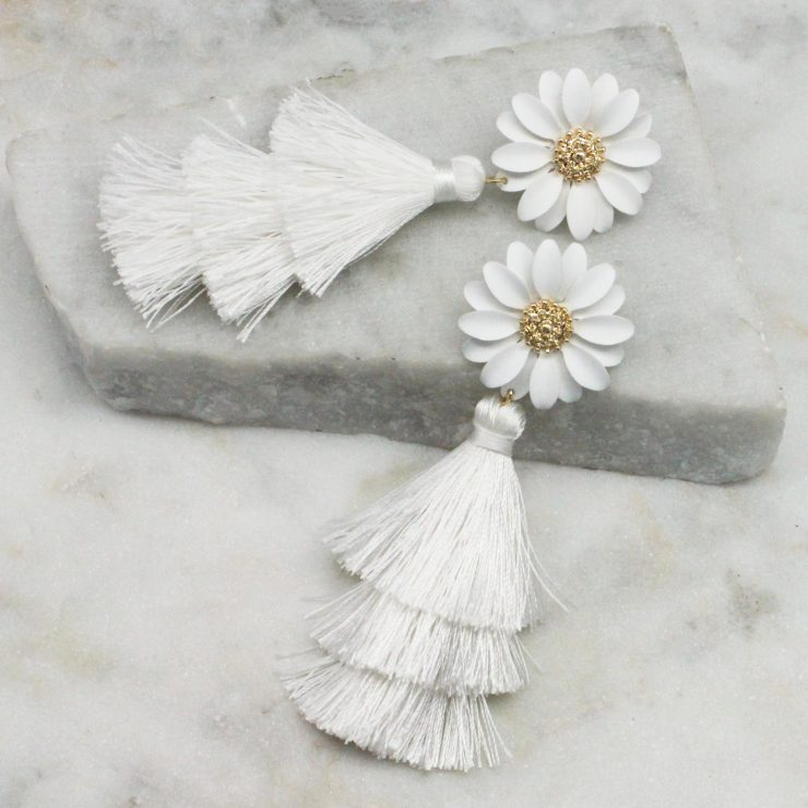A photo of the Daisy Tassel Earrings In White product