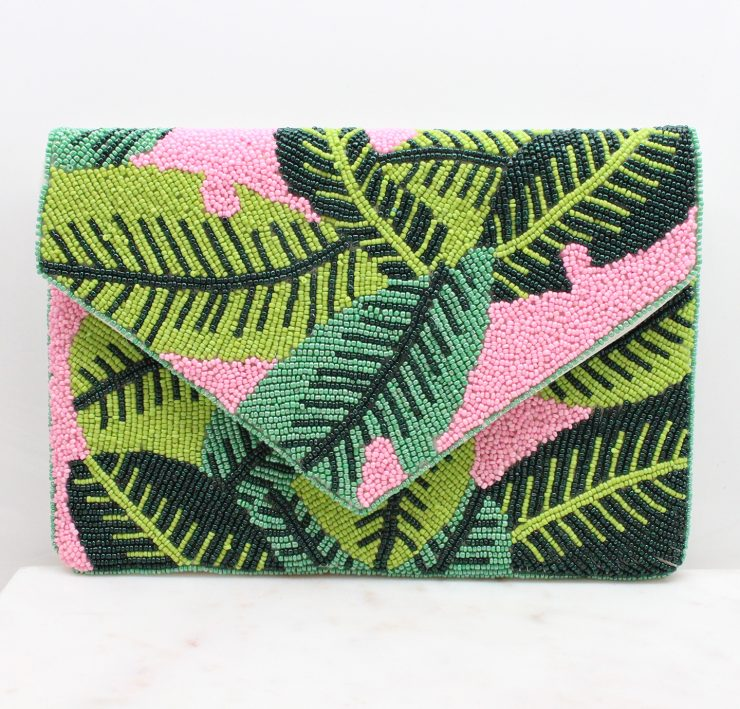A photo of the Banana Leaf Clutch In Pink product