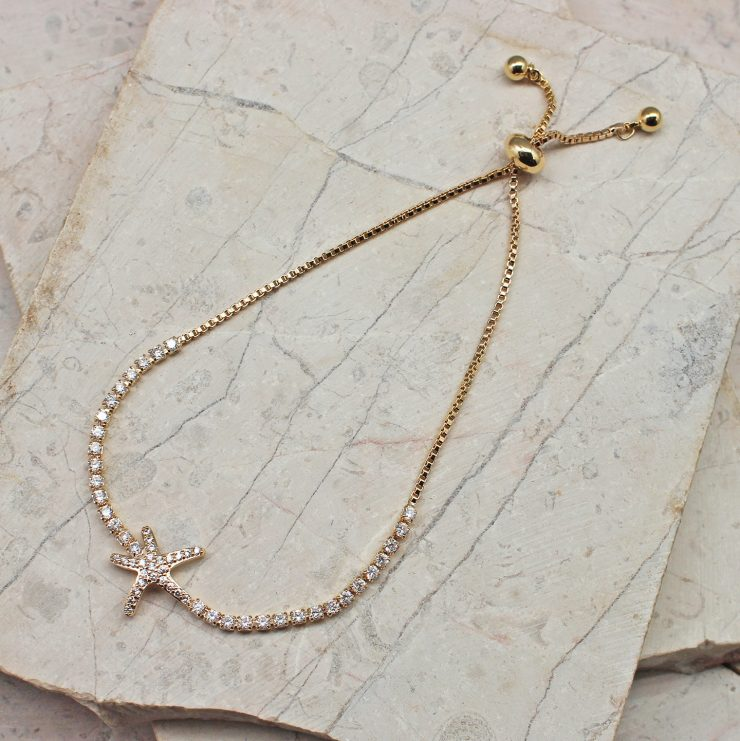 A photo of the Dazzling Starfish Adjustable Bracelet In Gold product