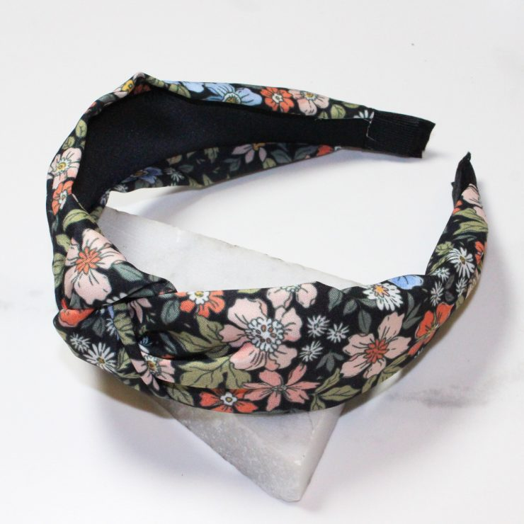 A photo of the Flower Bomb Headband In Black product