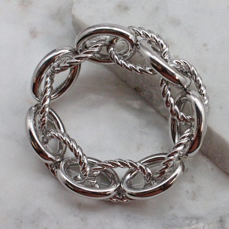 A photo of the Twisted Links Bracelet In Silver product