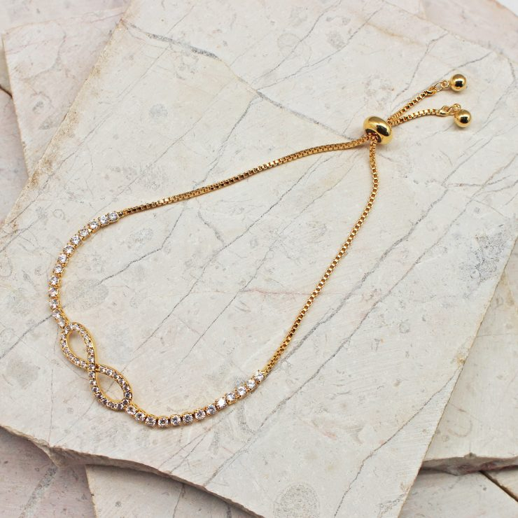 A photo of the Infinity Adjustable Bracelet In Gold product
