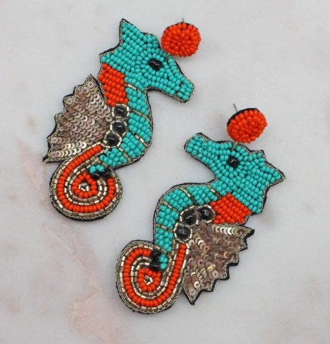 A photo of the Seahorse Earrings In Turquoise product