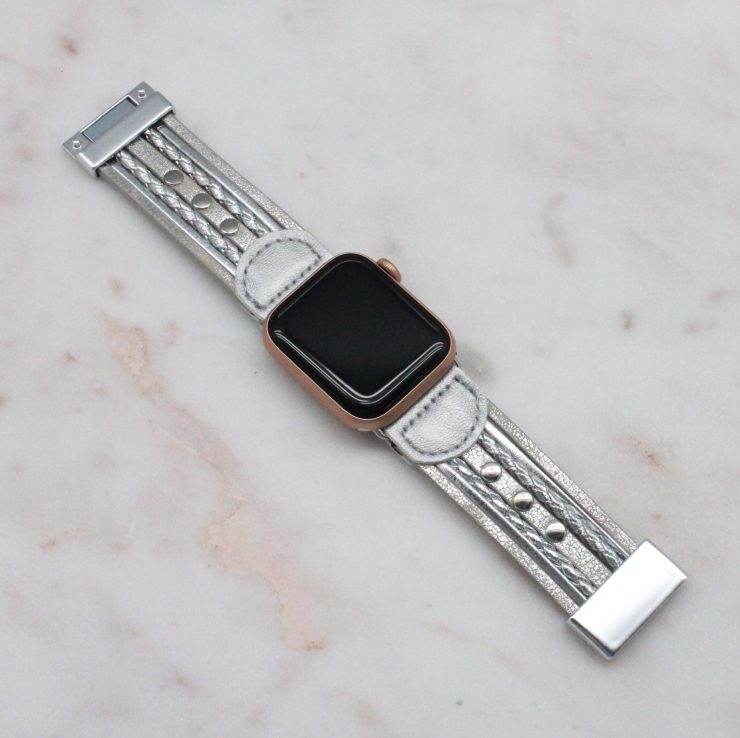 A photo of the Silver Faux Leather Apple Watch Band product
