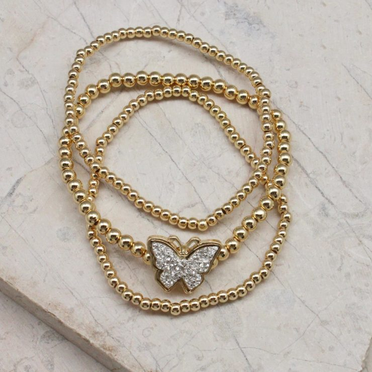 A photo of the Butterfly Beaded Stack Bracelet Set product