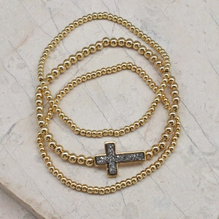 A photo of the Cross Beaded Stack Bracelet Set product