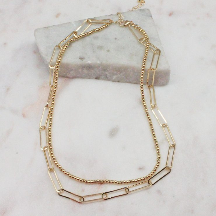 A photo of the Remi Necklace In Gold product